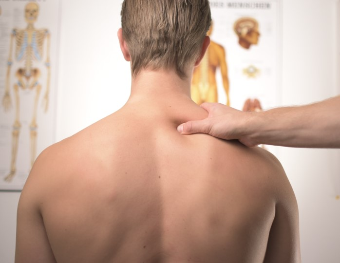 Physiotherapist assessing a shoulder
